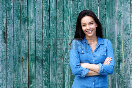 50593496-portrait-of-a-confident-woman-smiling-with-arms-crossed